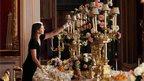 Exhibition curator Caroline de Guitaut arranges the Coronation State Banquet display