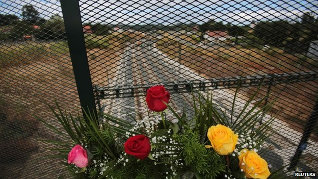 A bouquet of roses is placed at the site of a train crash in Santiago de Compostela on 25 July 2013