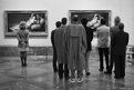 People look at paintings in the Prado Museum, Madrid, 1995