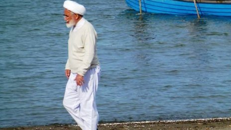 Mehdi Karroubi on a beach