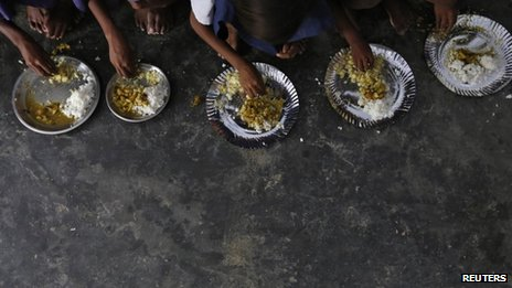 Schoolchildren eat their free Mid-Day meal, distributed by a government-run primary school at Brahimpur village in Chapra district of Bihar state on July 19, 2013