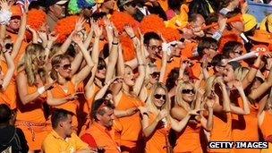 Dutch fans advertise a brand of beer in the world cup crowd 2010