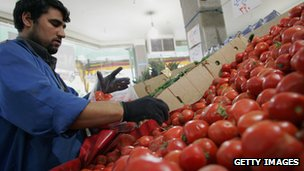 A Tehran grocer arranges a display of tomatoes in 2007