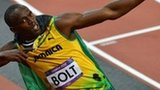 Jamaica's Usain Bolt celebrates after winning the men's 100m final