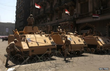 Armoured vehicles stand near Tahrir Square in Cairo, 26 July