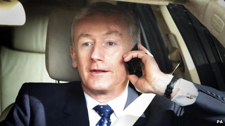 Fred Goodwin talking on the phone in a car