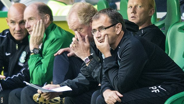 Pat Fenlon looks on from the dugout during Hibs' 7-0 home defeat