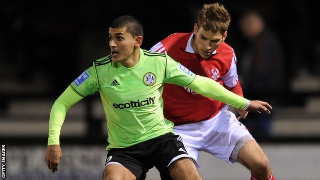 Forest Green striker Magno Vieira and Mickey Demetriou of Kidderminster Harriers