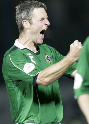 Stephen Craigan celebrates after a Windsor Park win over Latvia in 2006