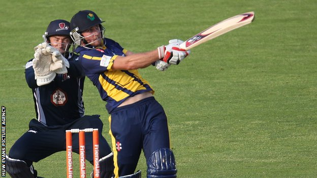 Chris Cooke hits a four against Northants