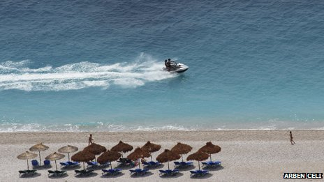 Jetski passes a beach in Albania