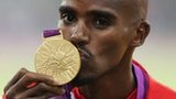 Mo Farah with an lympic gold medal