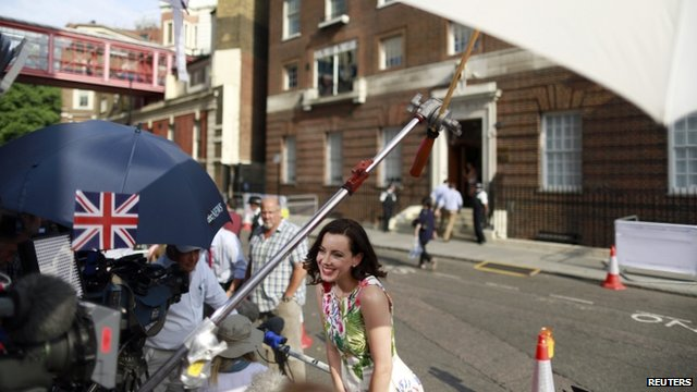 A television reporter opposite the Lindo Wing of St Mary's Hospital