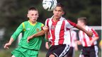 Donegal's Corey Lee Bogan and Sheffield United's Harley Brown keep their focus on the ball