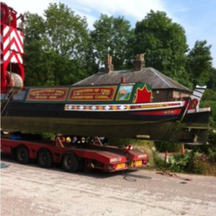 Narrowboat on low-loader