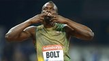 Usain Bolt reacts with the crowd at the Anniversary Games