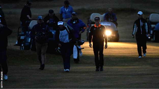 Bernhard Langer and Mark Wiebe walk down the fairway on the second hole of their play-off
