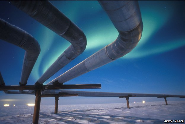 Alaska pipeline with background of Northern Lights