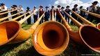 Alphorn players perform in Nendaz, Switzerland.