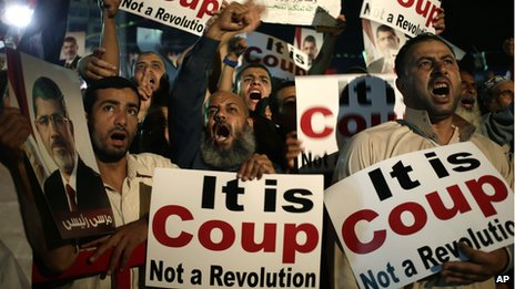 Supporters of Egypt's ousted President Mohammed Morsi chant slogans in Cairo, Egypt, on 28 July 2012