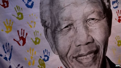 A picture taken on 18 July 2013 shows a portrait of former South African President Nelson Mandela outside the Medi Clinic Heart Hospital in Pretoria, South Africa