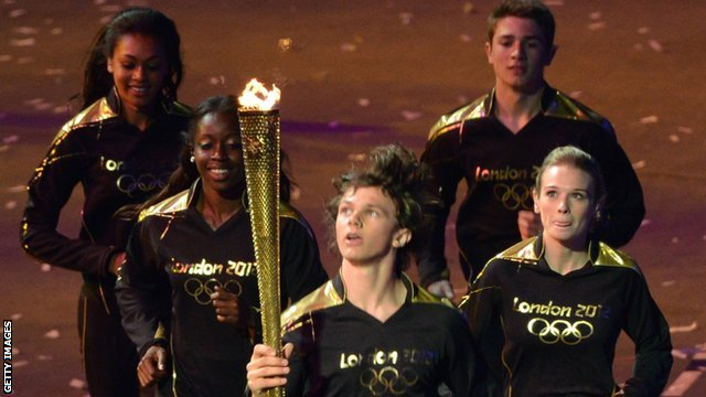 Aidan Reynolds carries the Olympic Torch during the opening ceremony at London 2012
