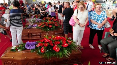 On July 30, 2013, relatives gather to grieve near to the coffins of the victims of the Monteforte Irpino coach crash.