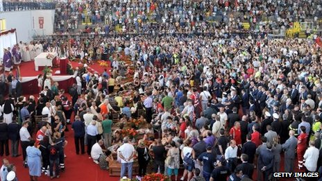 A general view of the funeral a mass funeral on July 30, 2013, in Monteruscello, southern Italy