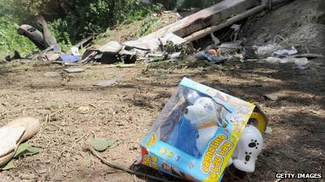 A view of a toy lies on the ground among the debris after a coach plunged from a flyover on the A16 motorway between Monteforte Irpino and Baiano on July 29, 2013 near Baiano, Italy.