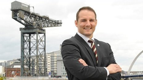 David Grevemberg at Glasgow's River Clyde with the Finnieston Crane in the background