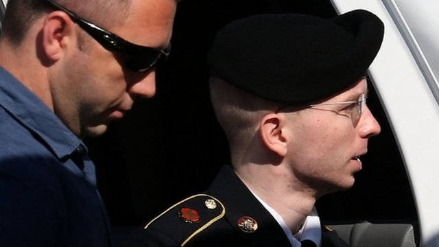 US Army Private First Class Bradley Manning is escorted by military police as arrives to hear the verdict in his military trial 30 July 2013