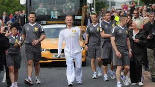 Mark Ormrod carrying the Olympic torch, 2012