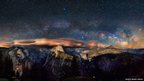 The photograph shows the Milky Way arching over Yosemite Valley in California's famous national park.