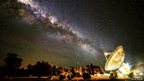 The Milky Way appears to line up with the giant 64m dish of a radio telescope at Parkes Observatory in Australia.