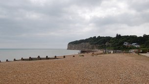Shingle beach at Pett Level looking towards Fairlight which behind the cliffs at Cliff End
