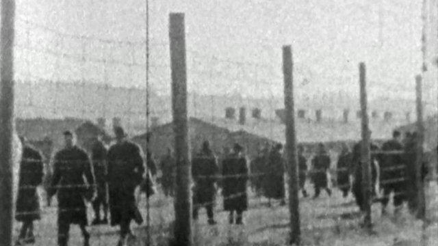 Archive film of prison fence