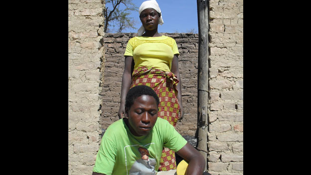 Chipo Matemo and her husband Daniel Bhobho, a Zanu-PF supporter, in their hut which was set ablaze in Mashonaland West