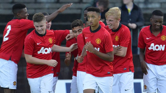 Manchester United celebrate victory over Strikers FC at the Milk Cup