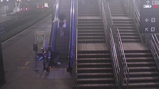 CCTV of man falling down escalator at Leeds station