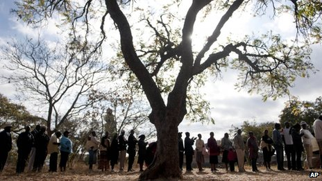 Zimbabweans queue to cast their votes in the country's general elections in Goromonzi, rural Zimbabwe Wednesday 31 July 2013