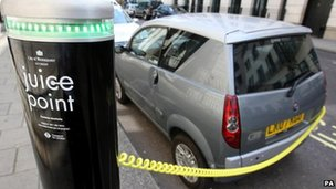 An electric car at a charging point in Westminster