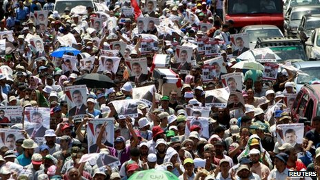 Supporters of deposed Egyptian President Mohamed Morsi at a march from Al-Fath Mosque to the defence ministry, in Cair on 30 July 2013