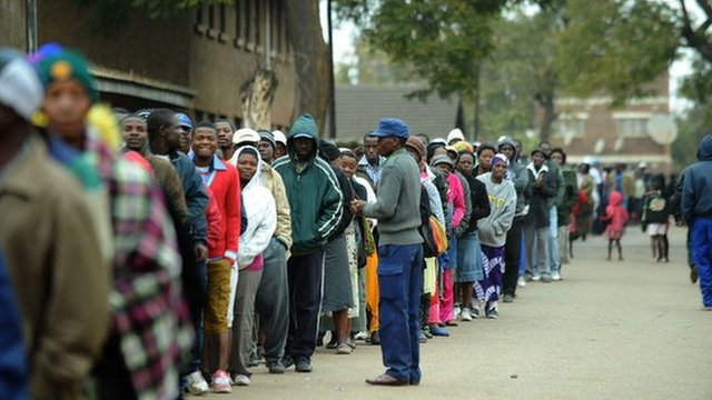 Voters queue up to vote in Harare, in Zimbabwe's election of 2013