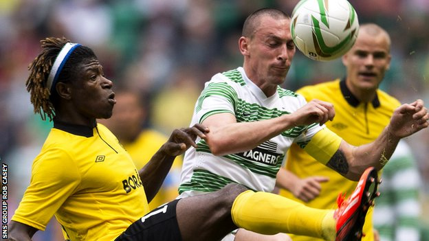 Scott Brown challenges Mo Bagura at Celtic Park