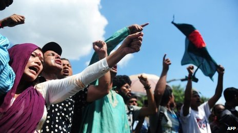 Bangladeshi social activists shout slogans against the verdict on Ghulam Azam in Dhaka on June 15, 2013.
