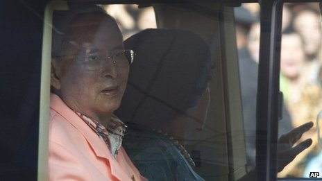 Thai King Bhumibol Adulyadej, left, and Queen Sirikit leave from Siriraj hospital in Bangkok, Thailand 1 Aug 2013