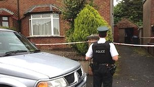 Police officer outside the house where the stabbing happened
