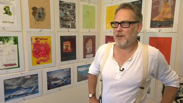 Vic Reeves with his artworks