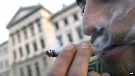 A man smokes marijuana outside the Uruguayan Congress on 31 July, 2013