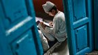 A Muslim boy learns to read the Koran